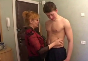 Sweet mommy is sucking her son dick with love