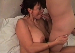 Big tit mom orally pleases her son
