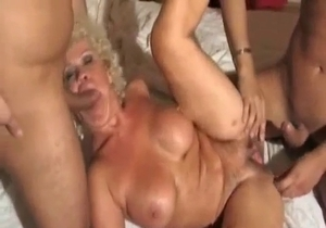 Big tit mom pleases her hubby and son